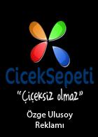 Özge Ulusoy Çiçek Sepeti Reklamlarında Tuğçe Yusufoğlu Elbisesi ile